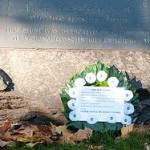 white poppy wreath laid at memorial