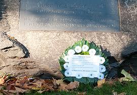 white poppy wreath laid at memorial